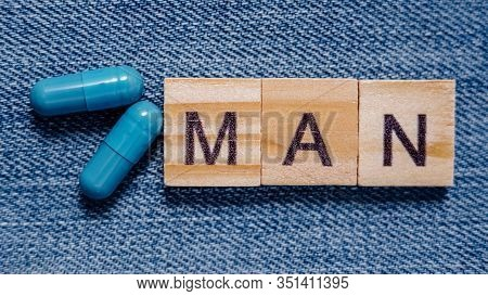 Banner. Two Blue Capsules And Inscription Man. Pills For Mens Health And Sexual Energy. Concept Of E