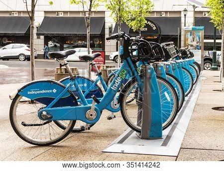 Philadelphia, Pennsylvania, Usa - 24 April 2019: Blue Indego Bikes Locked In A Rack Ready For Custom