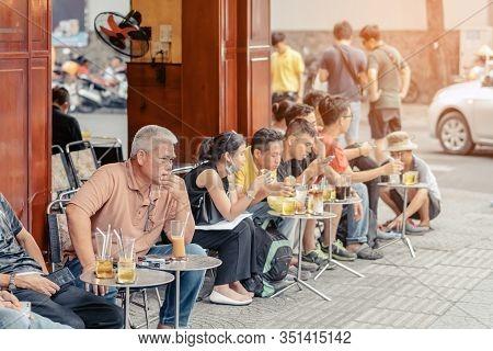 Ho Chi Minh City, Vietnam - April 24, 2019 : Unidentified People Drink Coffee, Tea Or Juice Fruit On