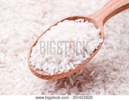 Grits Rice In A Wooden Spoon, Background