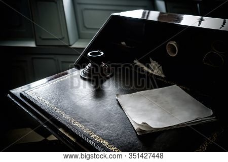 Quill Pen, Vintage Paper And Vintage Inkwell On Old Wooden Desk In The Battleship Office. Conceptual