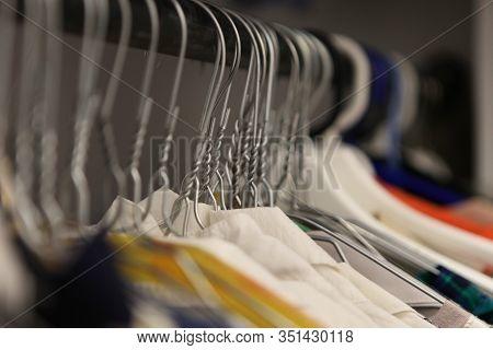Clothes Hanger Closeup Of Fashion Shop. Aluminium Hanger With Clothes. Clothes In A Cloakroom. Cloth