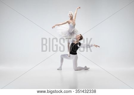 The Moon. Graceful Classic Ballet Dancers Dancing Isolated On White Studio Background. Couple In Ten