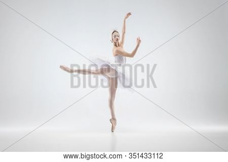 Graceful Classic Ballerina Dancing Isolated On White Studio Background. Woman In Tender Clothes Like