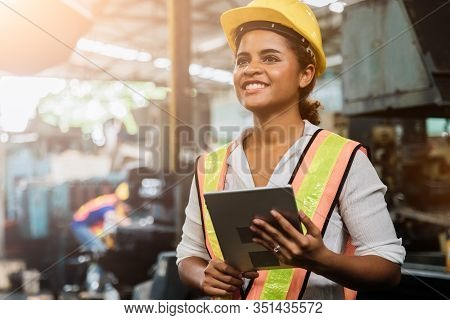 Industry Maintenance Engineer Woman Dark Skin Wearing Uniform And Safety Helmet Under Inspection And