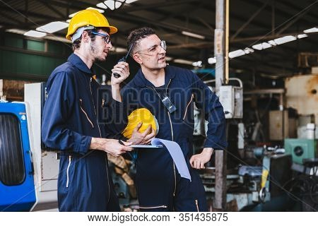 Group Of Industrial Factory Maintenance Engineers Inspect Relay Protection System Using Walkie Talki