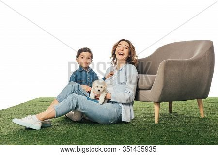 Smiling Mother With Havanese Puppy And Son Looking At Camera Isolated On White