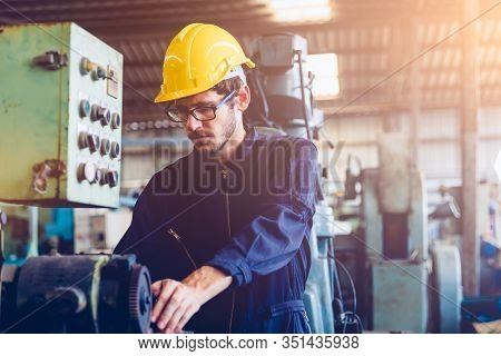 Industrial Factory Maintenance Engineers Inspect Relay Protection System Of Machinery With Copy Spac