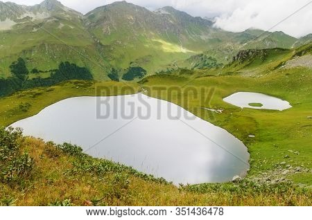 Two Small Lakes In The Caucasian Mountains. The Glacial Lakes Are Small, But Extremely Spectacular W