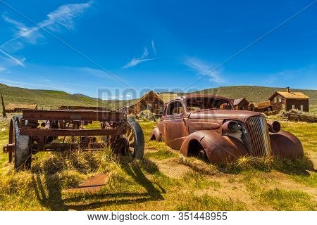 View Of The Wreck Of An Old Car In Bodie, Ghost Town. Bodie State Historic Park. Abandoned Wooden Ho