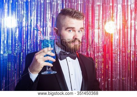 Club Party And Holidays Concept - Portrait Of Elegant Handsome Man In A Expensive Suit Holds Blue Co
