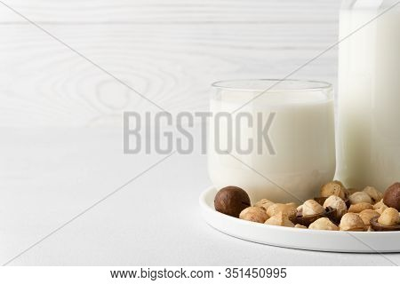 Dairy-free Milk. Macadamia Nut Milk In A Glass Cup On A White Background. Dairy Products Without Lac