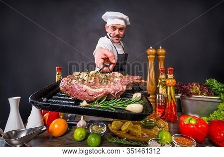 Catering Business Concept. Mustachioed Chef Planning To Cook A Beef Tomahawk Steak. Appetizing Cooki