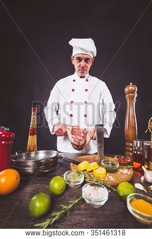 Chef Planning To Cook A Beef Tomahawk Steak