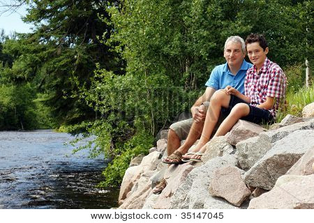 Father And Son By The River