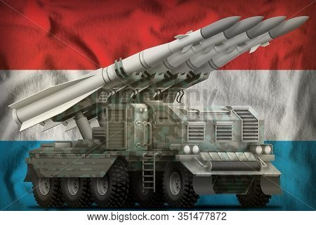 Tactical Short Range Ballistic Missile With Arctic Camouflage On The Luxembourg Flag Background. 3d