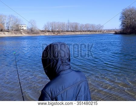 Sport Fisherman Hunting Predator Fish. Outdoor Fishing In River During Sunrise.hobby Sport.