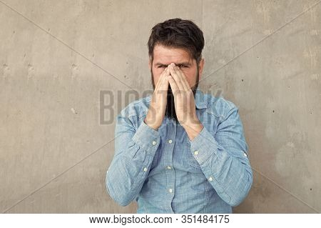 Runny Nose. Man Bearded Hipster With Sneezing Face Closed Eyes Close Up Concrete Wall Background. Br