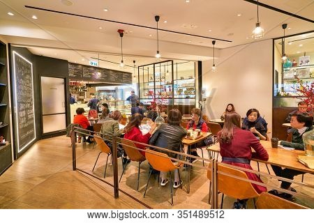 HONG KONG, CHINA - JANUARY 22, 2019: people sit at Agnes b La Loggia at IFC mall in Hong Kong.