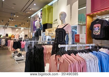 SINGAPORE - JANUARY 19, 2020: interior shot of H&M store in Singapore. H&M is a Swedish multinational clothing-retail company known for its fast-fashion clothing.