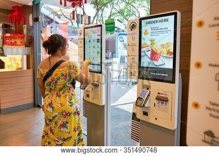 SINGAPORE - JANUARY 19, 2020: self-ordering kiosks at McDonald's restaurant in Singapore.