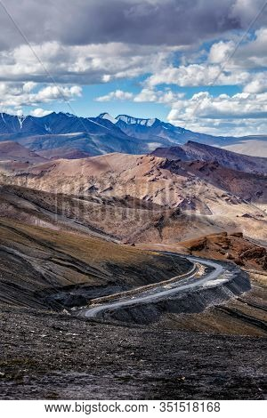Manali-Leh Highway road from Himachal to Ladakh. Beautiful Indian Himalayan landscape is on the way from Kullu valley to Jammu and Kashmir state. Earthroad highway is more than 400 km. North India