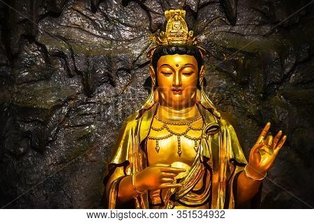 Close Up The Statue Golden Bodhisattva Guan Yin Located In The Cave At Hangzhou China.