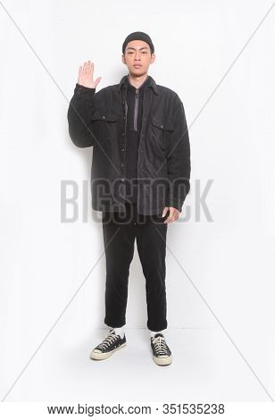 Full body young man wearing casual black clothes over white background doing stop sing with palm of the hand