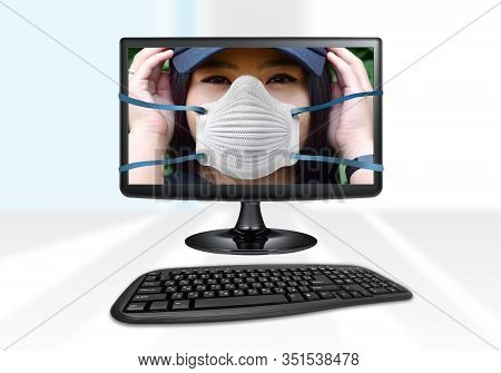 Photo Of A Computer With A Medical Mask On The Monitor As A Metaphor For A Computer Antivirus