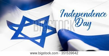 Close Up Shot Of Wavy Blue And White Israeli Flag. Happy Independence Day Israel, Top View, Flat Lay