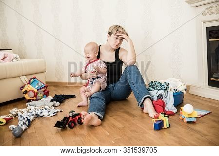 Mom Tired To Tidy Up The House. Child Scattered Toys. Childrens Room. Mess In The House