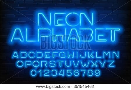 Neon Glowing Alphabet Font. Blue Neon Light Letters And Numbers. Brick Wall Background. Stock Vector