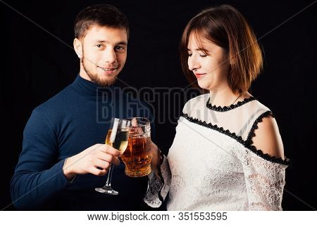A Man And A Woman On A Black Background, A Woman Drinking Beer And A Man Drinking Champagne Is A Ste