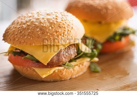 Tasty Grilled Home Made Burger Cooking With Beef, Tomato, Cheese, Cucumber And Lettuce. Concept Of A