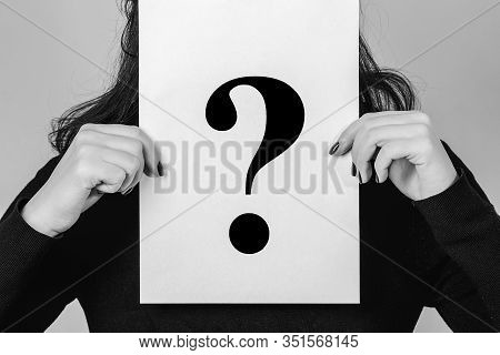 Unknown Woman Holding Question Mark. Female Problems And Stress. Girl Holding Paper Question Mark. A