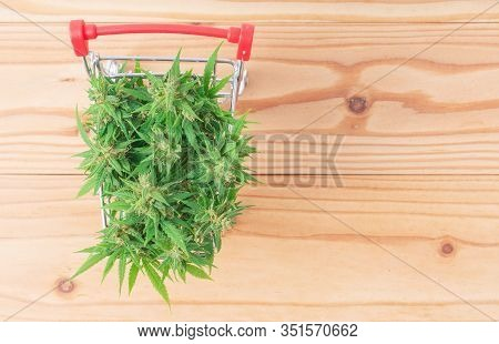 Marijuana Flower In Shopping Cart On Table