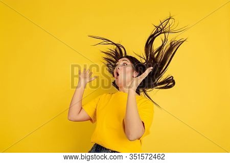 Astonished Crazy. Caucasian Womans Portrait Isolated On Yellow Studio Background. Beautiful Female B