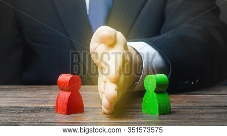 Man Puts His Hand Between Conflicting Persons. Avoidance Violence, Preventing Conflict Escalation. S