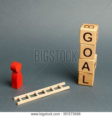 Blocks Tower With Word Goal And A Man Figurine With A Fallen Ladder. Tools And Tactics Objective Ach