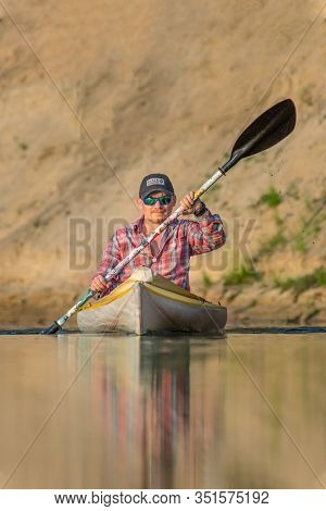 Ryazan, Russia - 06.08.2019: Front View Man With Tatoo Kayaking On River