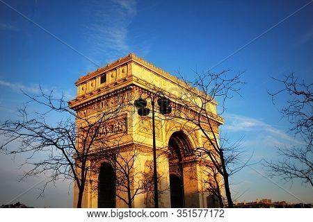 Triumphal Arch In Chaps Elysees , Paris, France. Architecture And Landmark Of Paris.