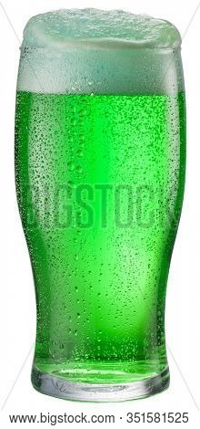Glass of green beer isolated on a white background. Contains clipping path. Green beer - a symbol of the feast of St. Patrick day.