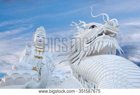 Exterior Of Wat Huay Pla Kang Temple Complex - Big Guan Yin And Dragon Statue At Sunset In Chiang Ra