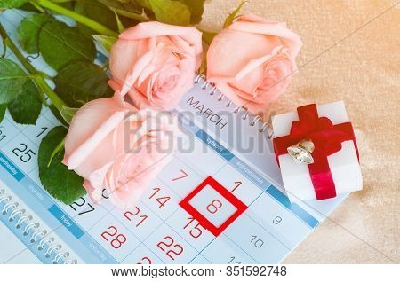 8 March card - peach roses over the calendar with framed 8 March date and box for jewel gift. 8 March composition. Festive 8 March still life