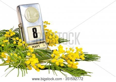 8 March card - vintage desk calendar with 8 March date and mimosa flowers isolated on white background, 8 March card. 8 March composition, 8 March still life