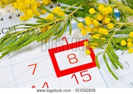 8 March postcard - mimosa flowers on the calendar with framed 8 March date - international women day. 8 March festive composition. 8 march card