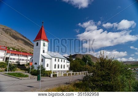View Of Icelandic Church In The Patreksfjordur City, West Fjord During Summertime. Iceland
