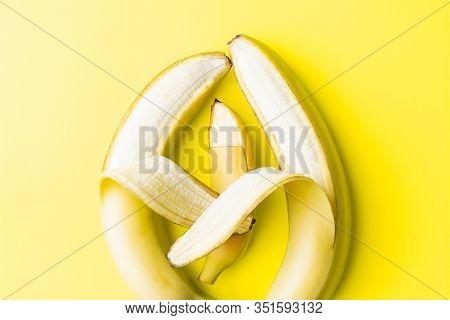 Conceptual Image Of Two Big Banana Parents Holding A Small Baby Banana