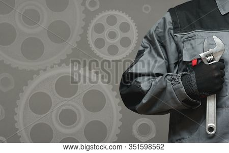Auto Service Business Card Template. Car Mechanic With Adjustable Wrench In Hand Close Up Over Gray