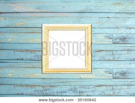 Gold Vintage Picture Frame On Blue Wood Background